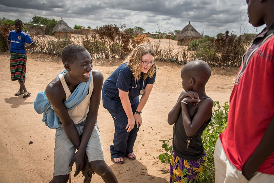 Sarah Kanoy, a nurse and career missionary in East Africa, greets children before the first day's clinic.