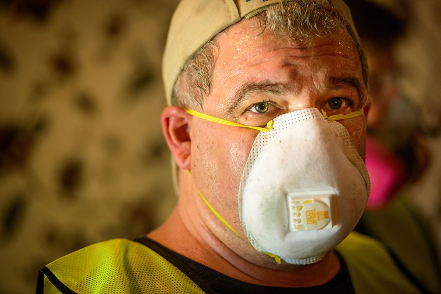 Volunteers like Don Teijelo of New Orleans have been essential in the muck-out efforts for flood-damaged homes.