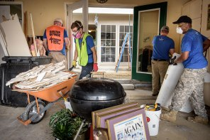Volunteers muck out the home of Trinity Lutheran Church parishioners Earl and Karen Willison.