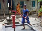 A young girl uses the new water well the LCMS provided to St. Peter Lutheran Church.