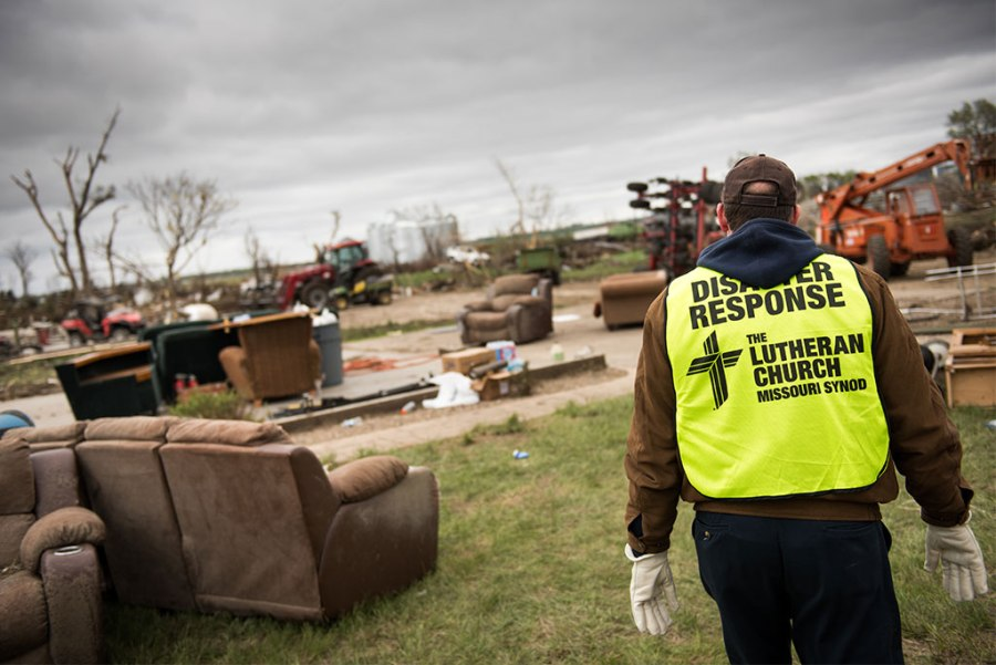 LCMS South Dakota District President Rev. Scott Sailer surveys damage caused by a tornado in Delmont, S.D., in May 2015. LCMS Disaster Response volunteers helped clean up the area and salvaged what they could from Zion Lutheran Church, which was destroyed in the storm. (LCMS Communications/Erik M. Lunsford)
