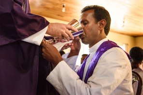 A Sri Lankan pastor receives the Lord's Supper from LCMS Area Director and missionary Rev. Roger James during a March 18 service at Lanka Lutheran Church in Nuwara Eliya, Sri Lanka. The Lanka Lutheran Church is a partner church with the LCMS.