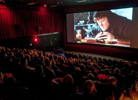 "Moviegoers watch the new full-length feature film ""Martin Luther: The Idea That Changed the World"" during its Feb. 13 premiere in Milwaukee. Funded by Thrivent Financial, the film brings to life the dramatic moments that shaped Luther and is available for screenings nationwide."