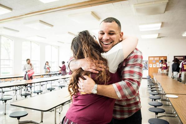 The Rev. Micah Glenn, new national missionary to Ferguson and former Lutheran High School North student, hugs a student he knows from his parish during a visit to the school in St. Louis on Wednesday, April 20, 2016.