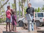 The Rev. Jacob Deal talks with children at a deep-water well installed by LCMS Disaster Response in partnership with Water for Life in Haiti after Hurricane Matthew. Deal, pastor at Saints Peter and Paul Evangelical Lutheran Church, Sharon, Pa., is conversant in Haitian Creole. (Mark Rychel)