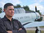 U.S. Air Force Col. Michael Madrid stands next to a vintage aircraft display outside Randolph Air Force Base, Texas. First Liberty Institute represents Madrid on the basis he was unlawfully punished because of his religious beliefs about marriage and sexuality. (Courtesy of First Liberty Institute)