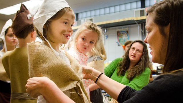 Nicole Mueth (right) helps Taylor Maack dress up as a peasant-laborer of the 1500s. Taylor is a student at Holy Cross Lutheran School in Collinsville, Ill., where members of the student body portrayed lords, ladies, knights, court musicians, town minstrels and peasants for a Renaissance-themed spring concert May 4 — just one of many events throughout the Synod celebrating the 500th anniversary of the Reformation this year. (LCMS/Frank Kohn)