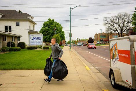 High-school student Reece Riegel delivers Christian care kits to a pregnancy resource center in nearby Fairmount, Minn.
