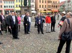 "In this scene from the new, two-part LCMS video ""The Luther Mile,"" Synod President Rev. Dr. Matthew C. Harrison (second from right, in hat) and Rev. Dr. Hans-Jörg Voigt (right), bishop of the Independent Evangelical-Lutheran Church, the LCMS partner church in Germany, discuss historic Reformation sites with a tour group in the Wittenberg, Germany, town square. The video is among resources available to help congregations and others celebrate the 500th anniversary of the Reformation this fall. (LCMS/Al Dowbnia)"