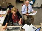 Paula Schlueter Ross, left, and Joe Isenhower Jr., right, work on this July/August issue of Reporter prior to Isenhower's June 30 retirement. Ross succeeds her former colleague as the newspaper's new managing editor. (LCMS/Erik M. Lunsford)