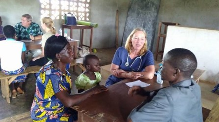 Stephanie Schulte, Coordinator for Mercy Work in West & Central Africa, takes a health history.