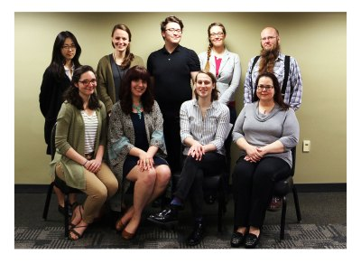 """Head of the Purdue Archives and Special Collections and Professor Sammie Morris (front row, far right) with her graduate students who compiled the """"Voices, Identities, & Silences: Investigating 150 Years of Diversity in the Purdue Archives"""" online exhibit. Students are (back row, L to R): Narim Kim, Erika Gotfredson, Lee Hibbard, Arielle McKee, and E. C. McGregor Boyle III; (front row, L to R): Maddie Gehling, Elise Robbins, and Dee McCormick."""
