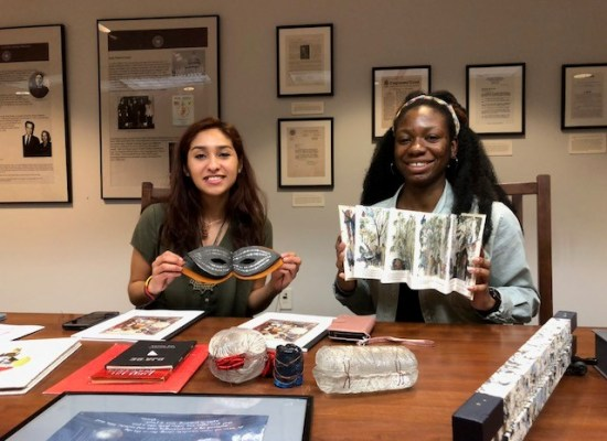 students holding book arts