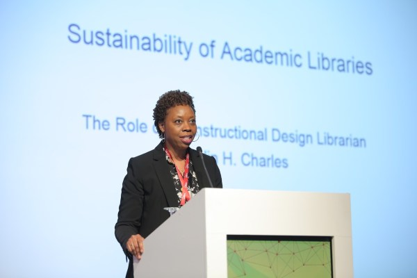 Librarian on stage presenting
