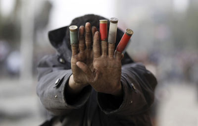 An anti-Morsi protester in Tahrir Square (Photo: Amr Abdallah Dalsh / Reuters)