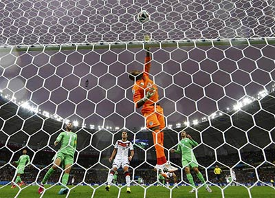 Algeria's goalkeeper Rais Mbolhi makes a save during the second round match again Germany in the 2014 World Cup (Stefano Rellandini / Reuters)