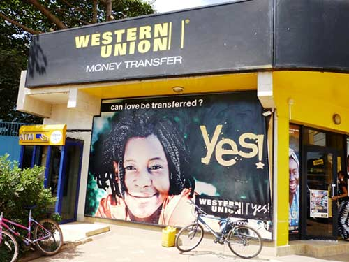 Can love be transferred?  Western Union bureau at Serrekunda assures its clients that this is so. © Sylvia Chant