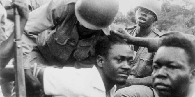 Hands tied: Lumumba's capture in Léopoldville, December 1960. (Bettman / Corbis)