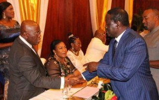 Ghana President Nana Akufo-Addo shakes hands with Kenya opposition leader Raila Odinga during his inauguration