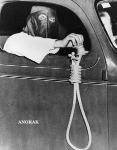 A hangman's noose dangling from an automobile driven by a hooded Ku Klux Klan member is among the grim warnings to blacks to stay away from the voting places in the municipal primary election at Miami, Fla., on May 3, 1939. In spite of the threats, 616 blacks exercised their right to vote. (AP Photo)