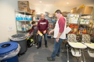 Kelly Sallee, '96, his son, Drew Sallee, and Darrell Williams, '01 and '03, retrieve cleaning and cooking supplies from a pantry at a Ronald McDonald House in Kansas City. They were volunteering as part of a Bear Breaks Immersion Trip. Photos by Kevin White/Missouri State University