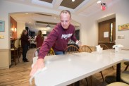 MSU alumni and students making and serving a meal to about 50 Ronald McDonald House residents in the Kansas City area. Photos by Kevin White/Missouri State University