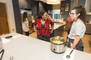 MSU alumna Erica Johnson, '02, laughs while talking with current Missouri State students. Alumni were invited to join current Bears at a volunteer opportunity in Kansas City, preparing a meal for residents at two Ronald McDonald Houses. Photos by Kevin White/Missouri State University