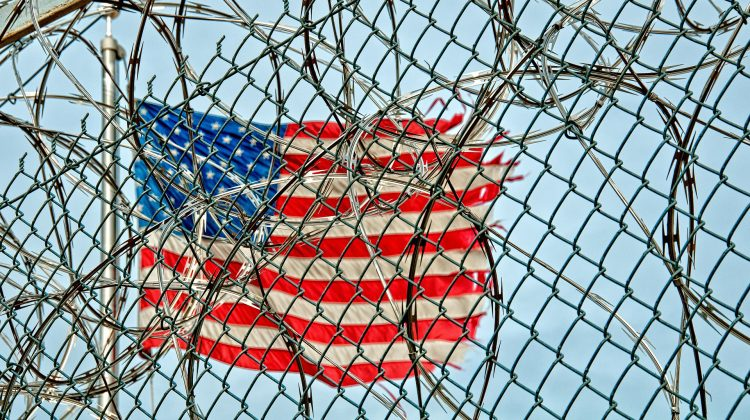 flag behind barbed wire