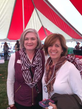 Alumna Michelle Nahon Moulder hangs out in the Alumni Association tent at BearFest Village.