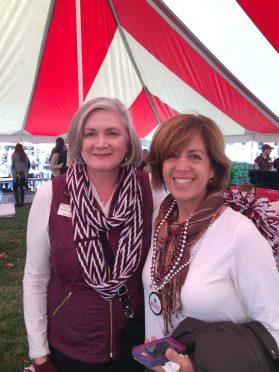 Alumna Michelle Nahon Moulder hangs out in the Alumni Association tent at BearFest Village.
