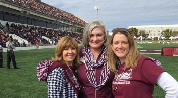 Alumni Association board members Tina (Chasteen) Stillwell, Michelle Nahon Moulder and Tara Calton share their love for MSU at the football game.