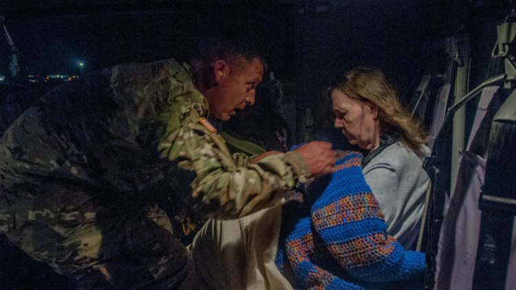 command sergeant assists elderly survivor