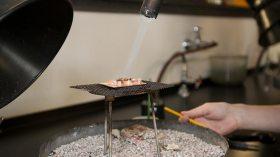 Student heating metal