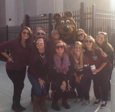 Friends pose with Boomer in front of Plaster Stadium