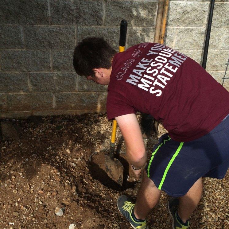 studen shovels dirt