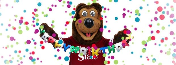 Boomer with happy birthday sign