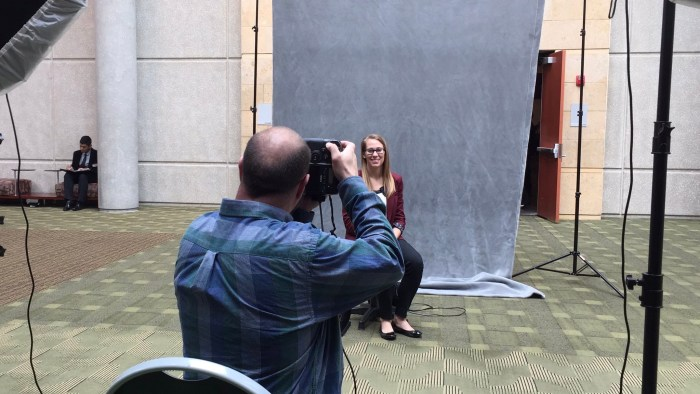 MSU employee having photo taken during free portrait days