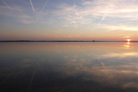 Sonneuntergang über Südost-Bucht (Foto: Tore J. Mayland-Quellhorst).