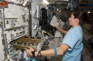 Astronaut Nicole Stott works with the high-density protein crystal growth (HDPCG) apparatus aboard the International Space Station. (NASA)