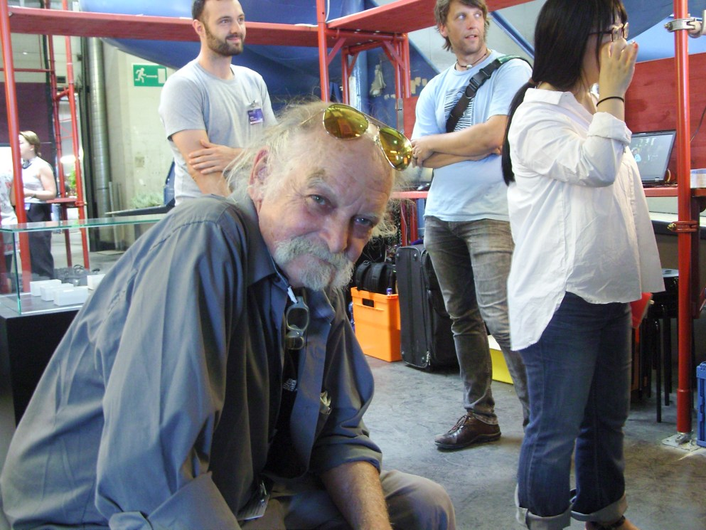 artist joe davis poiting at our camera lens