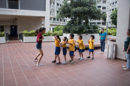 Hall residents and the children having fun in outdoor games.