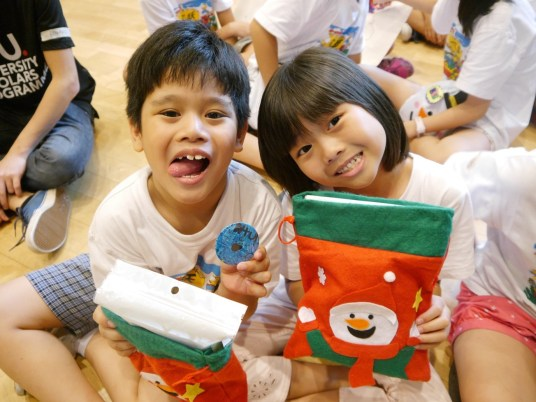 Delight on the faces of the children as they received their goodie bags.