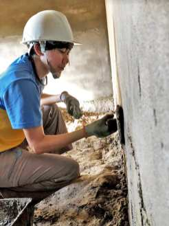 Plastering a wall during construction work.
