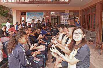 Learning sign language with the Deaf students on the first day of service
