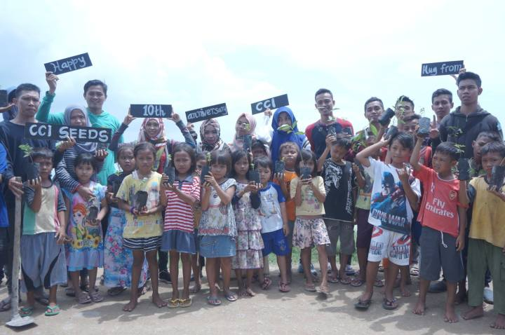 Local children and volunteers celebrating CCI in Indonesia.
