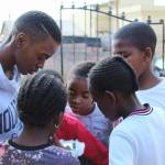Kgothatso Mohale talking to local children in South Africa