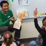 CCI participant Adi reads to kids