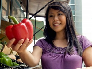 woman holding pepper