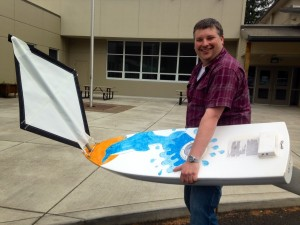 Toledo High School teacher Ben Ewing holds the SS Dolphin which was built by Coos Bay middle school students and will be launched from the R/V Thompson over Memorial Day weekend.