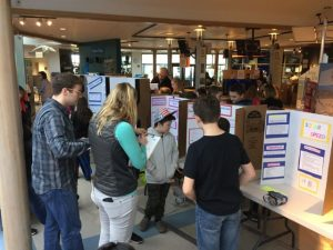 Students share their solar device with the engineering judges